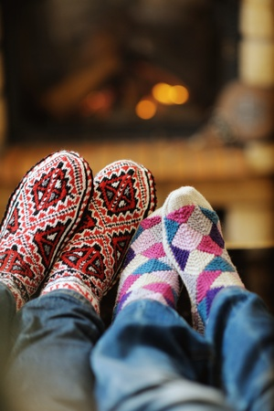 happy Young romantic couple relax on sofa in front of fireplace at winter season in home photo