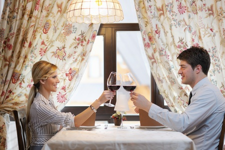 A young couple having romantic  dinner at a restaurant photo
