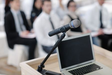 press conference: business laptop and microphotone at podium on seminar conference education Stock Photo