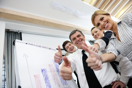 Senior male business man giving a presentation at a  meeting at modern light office on a table board Stock Photo - 13402261