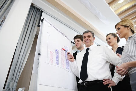 Senior male business man giving a presentation at a  meeting at modern light office on a table board Stock Photo - 13402260