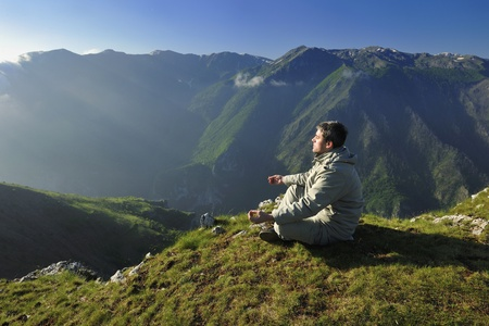healthy young man practice yoga in height mountain at early morning and sunrise Stock Photo - 13402571