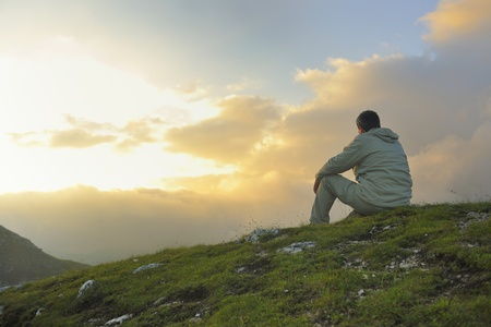 look: healthy young man practice yoga in height mountain at early morning and sunrise Stock Photo