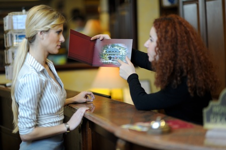 business woman  at the reception of a hotel checking in Stock Photo - 17632815