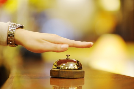 business woman  at the reception of a hotel checking in Stock Photo - 13402263