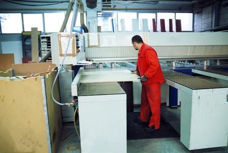 engineering people manofacturing industry with big modern computer mashines i company  hall Stock Photo - 13464482