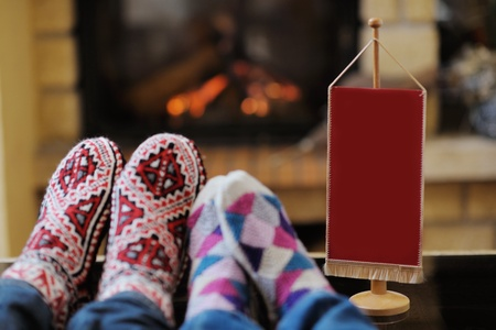happy Young romantic couple and relaxing sofa in front of fireplace at winter season in home photo