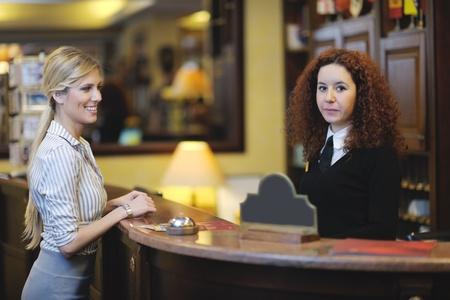 business woman  at the reception of a hotel checking in Stock Photo - 13487883