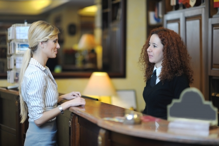 business woman  at the reception of a hotel checking in photo