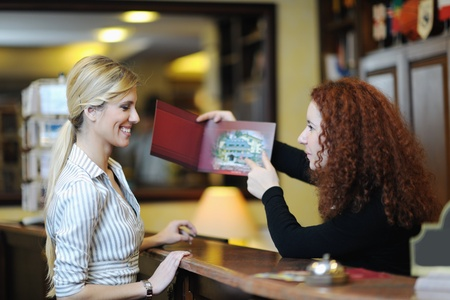 business woman  at the reception of a hotel checking in Stock Photo - 13487891