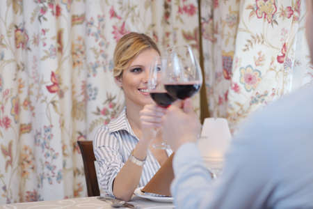 A young couple having dinner at a restaurant photo