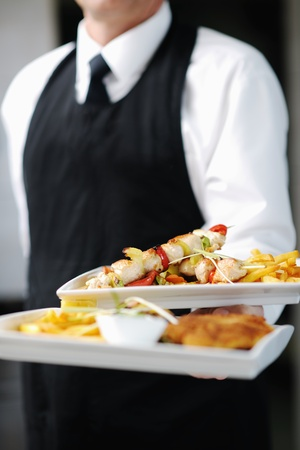 hotel service: beautiful young chef woman prepare and decorating tasty food in kitchen