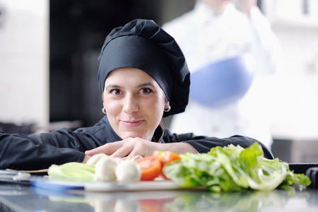 chefs: beautiful young chef woman prepare and decorating tasty food in kitchen