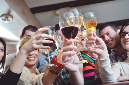 wine bar: Group of happy young people drink wine  at party disco restaurant