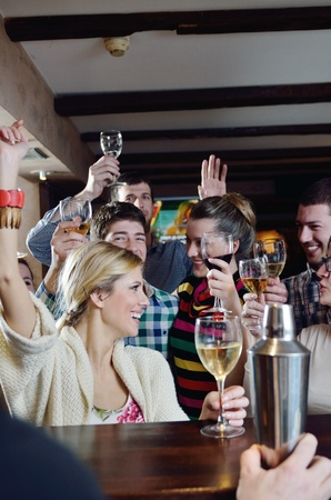 group of young adults: Group of happy young people drink wine  at party disco restaurant