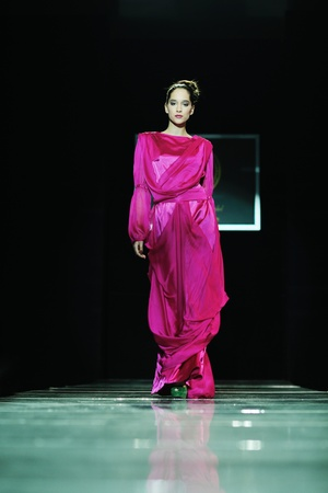 beautiful young fashion model woman walking on  show event photo