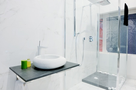 Modern new small bathroom interior with bath tub. photo