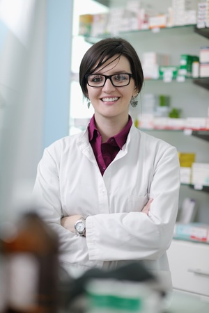 Happy cheerful pharmacist chemist woman standing in pharmacy drugstore Stock Photo - 13579152