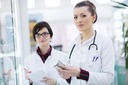 team of  pharmacist chemist woman group  standing in pharmacy drugstore Stock Photo - 13578439