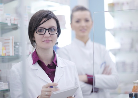 team of  pharmacist chemist woman group  standing in pharmacy drugstore Stock Photo - 13578024
