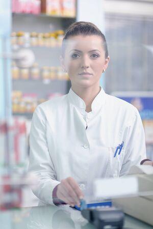 Happy cheerful pharmacist chemist woman standing in pharmacy drugstore Stock Photo - 13581568