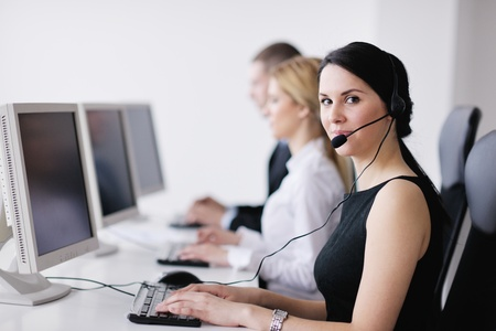 business people group with  headphones giving support in  help desk office to customers, manager giving training and education instructions photo