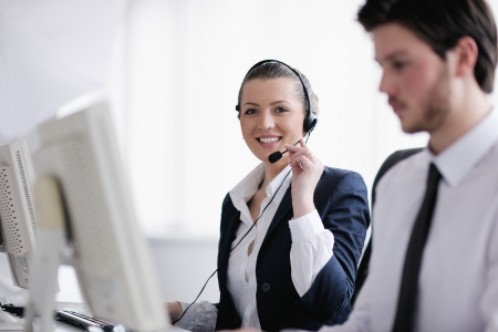 business people group with  headphones giving support in  help desk office to customers, manager giving training and education instructions Stock Photo - 13577814