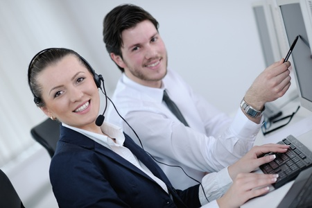 business people group with  headphones giving support in  help desk office to customers, manager giving training and education instructions Stock Photo - 13577813