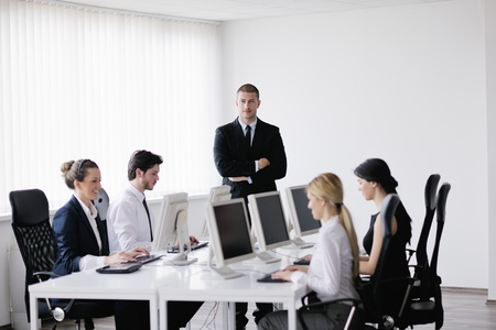 business people group with  headphones giving support in  help desk office to customers, manager giving training and education instructions Stock Photo - 13577926