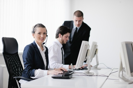 business people group with  headphones giving support in  help desk office to customers, manager giving training and education instructions Stock Photo - 13577934
