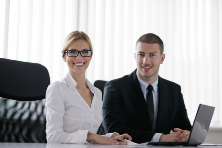 Group of happy young  business people in a meeting at office Stock Photo - 13577940