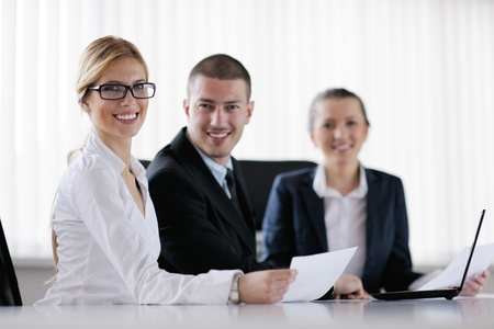 Group of happy young  business people in a meeting at office Stock Photo - 13577882