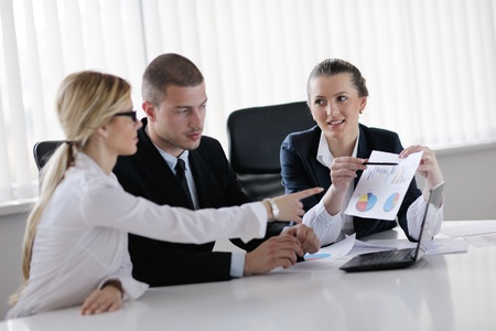 Group of happy young  business people in a meeting at office Stock Photo - 13577801