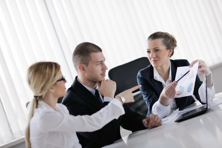 Group of happy young  business people in a meeting at office Stock Photo - 13577767