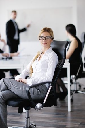 business woman  with her staff,  people group in background at modern bright office indoors Stock Photo - 13577815