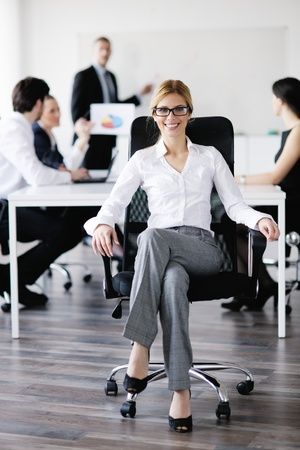 business woman  with her staff,  people group in background at modern bright office indoors Stock Photo - 13578474