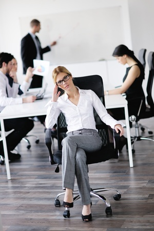 business woman  with her staff,  people group in background at modern bright office indoors Stock Photo - 13578479