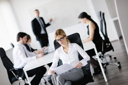 business woman  with her staff,  people group in background at modern bright office indoors Stock Photo - 13578185