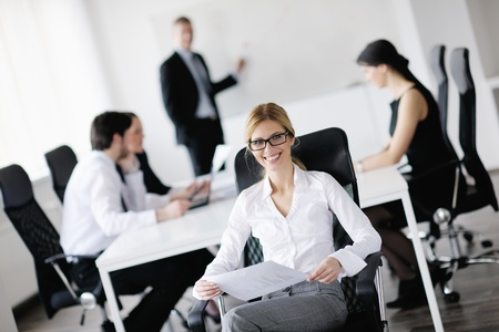 business woman  with her staff,  people group in background at modern bright office indoors Stock Photo - 13578162