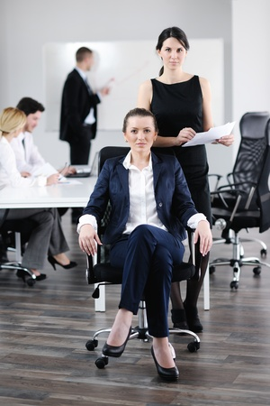 business woman  with her staff,  people group in background at modern bright office indoors Stock Photo - 13578838