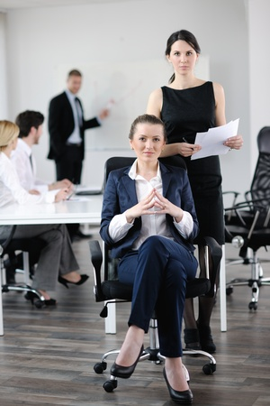 business woman  with her staff,  people group in background at modern bright office indoors Stock Photo - 13579038