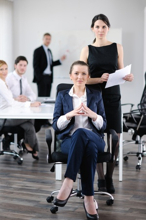 business woman  with her staff,  people group in background at modern bright office indoors Stock Photo - 13578726