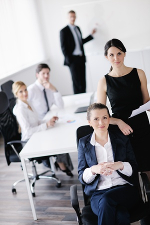 business woman  with her staff,  people group in background at modern bright office indoors Stock Photo - 13578928