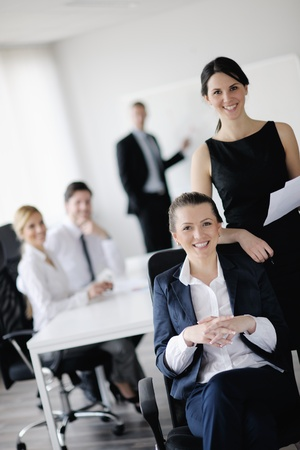 business woman  with her staff,  people group in background at modern bright office indoors Stock Photo - 13577807