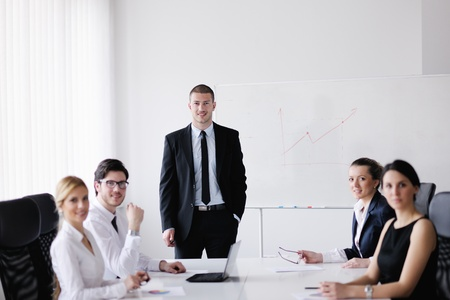 Group of happy young  business people in a meeting at office Stock Photo - 13577877