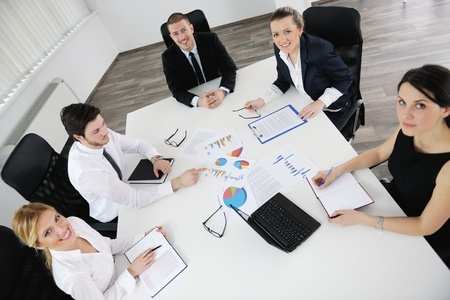 Group of happy young  business people in a meeting at office Stock Photo - 13578519