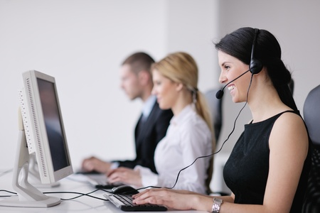 customer assistant: business people group with  headphones giving support in  help desk office to customers, manager giving training and education instructions Stock Photo