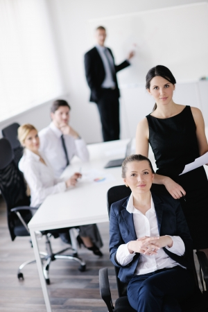 business woman  with her staff,  people group in background at modern bright office indoors Stock Photo - 13628500