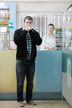 young pharmacist suggesting medical drug to buyer in pharmacy drugstore Stock Photo - 13661788