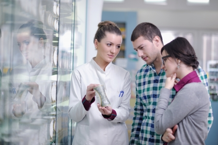 young pharmacist suggesting medical drug to buyer in pharmacy drugstore Stock Photo - 13661807